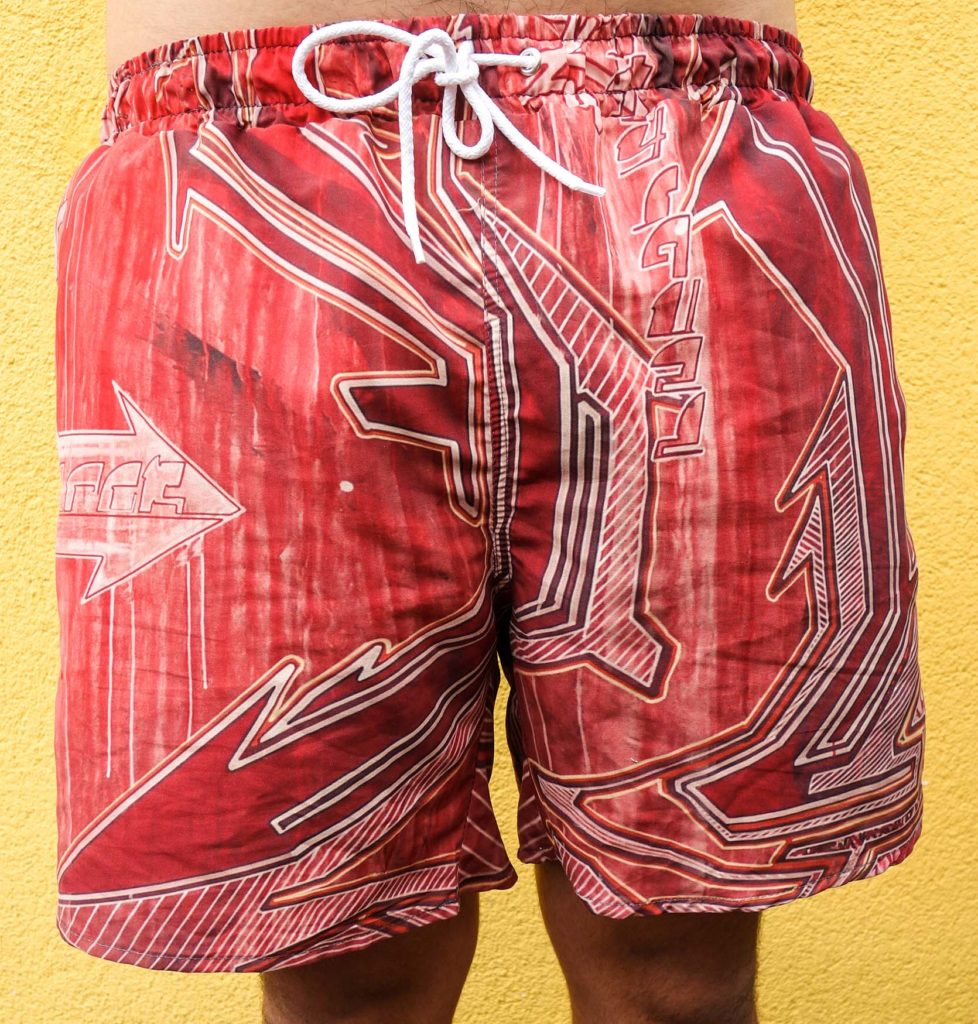 red bathing short with white graphic z-rok designs